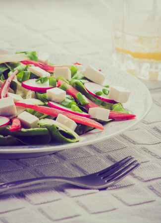 cros: Vintage photo of salad with feta cheese, lettuce, radish and peppers. vegetable salad