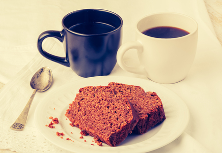 lomography: Vintage photo of soft homemade gingerbread cake and cups of coffee