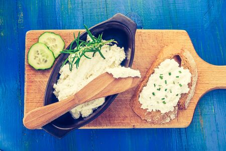 Vintage photo of cottage cheese on a bread, cottage cheese in bowl Stock Photo