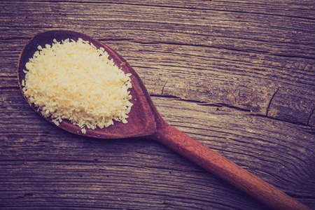 desiccated: Vintage photo of wooden spoon of desiccated coconut