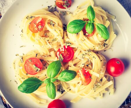 lomography: Vintage photo of pasta with tomatoes, cheese and basil