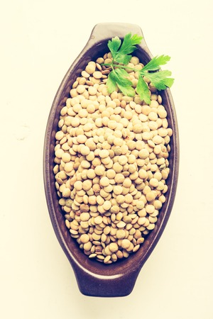 lomography: Vintage photo of lentil in a clay bowl