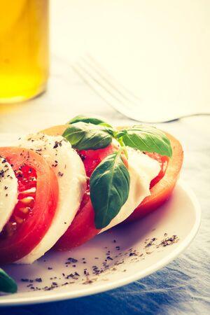 lomography: vintage photo of Traditional mozzarella with tomato. Mediterranean salad