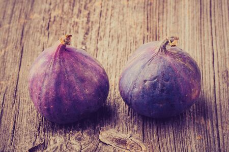 lomography: Vintage photo of fresh ripe figs on wooden background, food photo