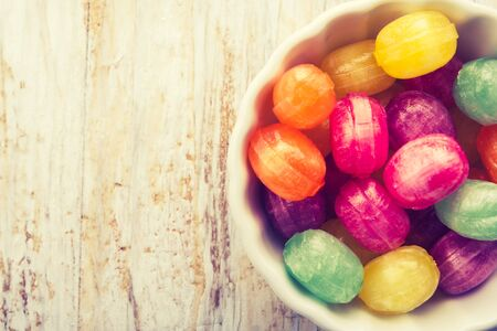 cros: Vintage photo of colorful candies in white bowl