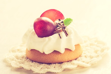 bisquit: Vintage photo of small biscuits with fruits and whipped cream