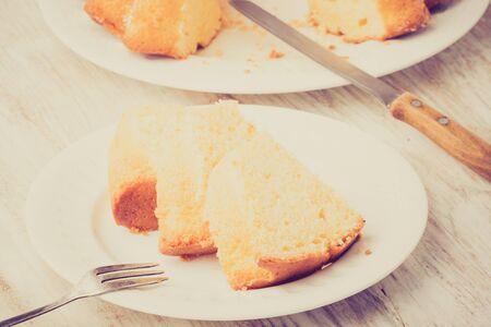 lemon cake: Vintage photo of round-shaped tasty lemon cake Stock Photo