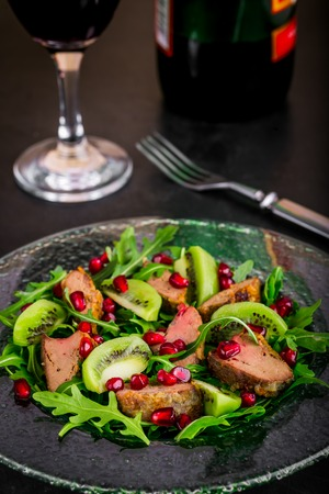 giblets: Salad appetizer with chicken liver, arugula, kiwi and pomegranate