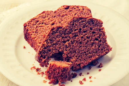 gingerbread cake: Vintage photo of soft homemade gingerbread cake on white plate