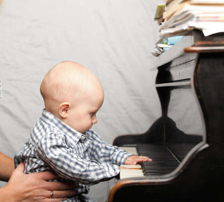 beautiful little baby boy learning plays piano Stock Photo - 10542122
