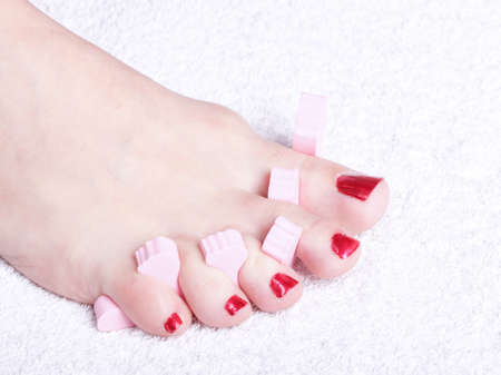 Close-up of female feet with red polished nails Stock Photo - 10580406