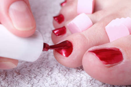 Close-up of female feet with red polished nails carefree, chiropody Stock Photo - 10580414