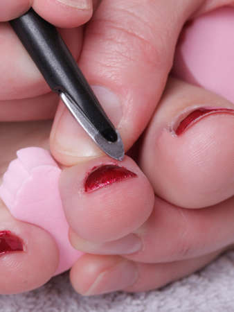 Close-up of female feet with red polished nails carefree, chiropody Stock Photo - 10580404