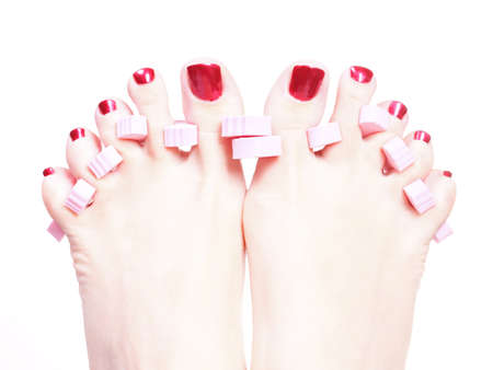 Close-up of female feet with red polished nails carefree, chiropody Stock Photo - 10659187
