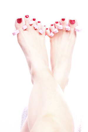 Close-up of female feet with red polished nails carefree, chiropody Stock Photo - 10659190