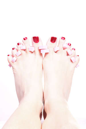 Close-up of female feet with red polished nails carefree, chiropody Stock Photo - 10689215