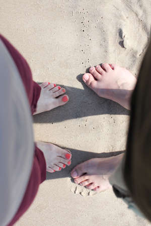 nice legs: nice legs woman and man in water, pedicure red nail sand beach