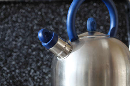 kettle and gas cooker on modern kitchen photo