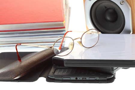 eBook reader pile of books, isolated on white multimedia black audio speaker photo