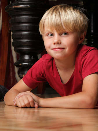 portrait of 6 year boy, male child sitting on floor Stock Photo - 11148808
