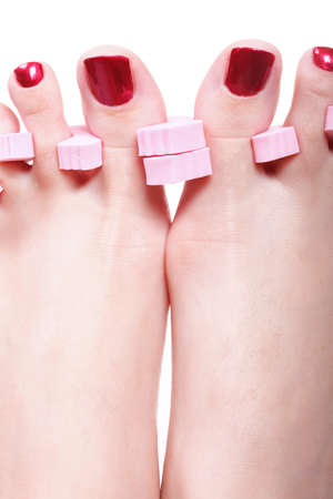 Close-up of female feet with red polished nails carefree, chiropody Stock Photo - 11210372
