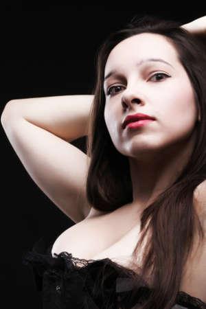 vintage brunette i- white corselette black background Stock Photo - 11344588