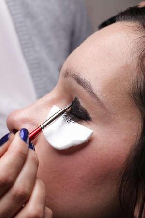 Woman applying eyeshadow using professional makeup brush Stock Photo - 11344594