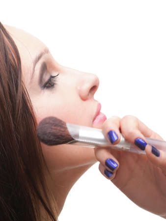 beautiful young brunette woman applying powder with a brush isolated on white Stock Photo - 11344583