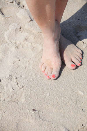 nice legs pedicure red nail sand beach photo