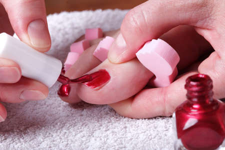 Close-up of female feet with red polished nails carefree, chiropody Stock Photo