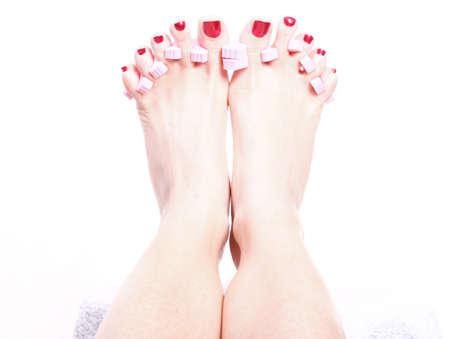 painted toes: Close-up of female feet with red polished nails carefree, chiropody Stock Photo