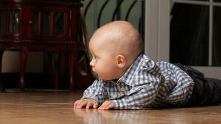 portrait of 6 months boy, male child sitting on floor Stock Photo - 11706338