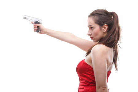 Sexy young woman in red with a gun isolated on white photo