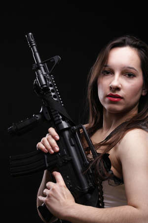 female sexuality: Sexy women - Girl holding an Assault Rifle, black background