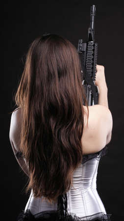 sexy army girl: Sexy women - Girl holding an Assault Rifle, black background