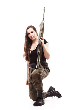 camos: Beautiful woman with rifle plastic Military Army girl Holding Gun white isolated background Stock Photo