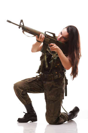Beautiful woman with rifle plastic Military Army girl Holding Gun white isolated background Stock Photo