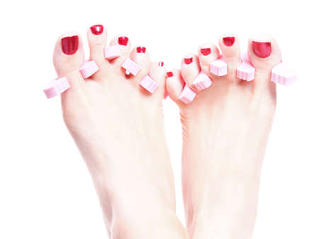 Close-up of female feet with red polished nails carefree, chiropody photo
