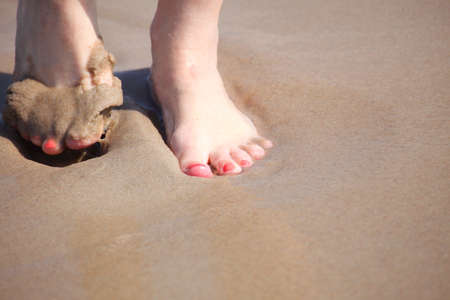 nice legs in water, nice pedicure red nail sand beach photo