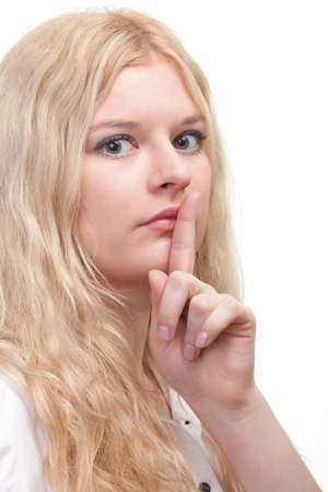Young woman blonde girl asking for silence white isolated Stock Photo - 11833364