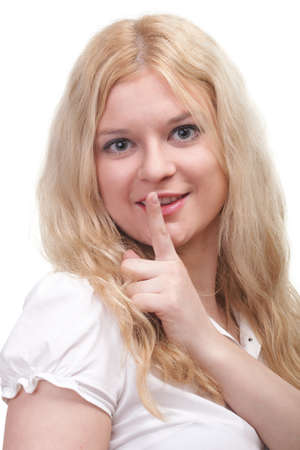 Young woman blonde girl asking for silence white isolated photo