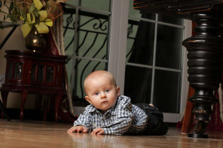 portrait of 6 months boy, male child sitting on floor Stock Photo - 11964723