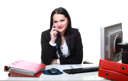 modern business woman talking phone sitting at office desk photo