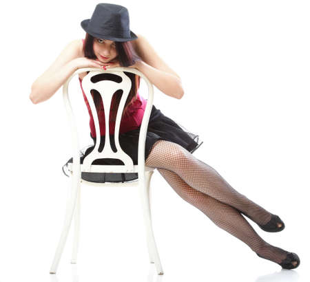 entertainment pastime girl dance in red corset chair white isolated showgirl, Stock Photo - 12268901