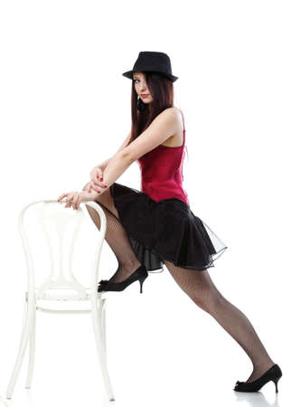 red corset: entertainment pastime girl dance in red corset chair white isolated showgirl,