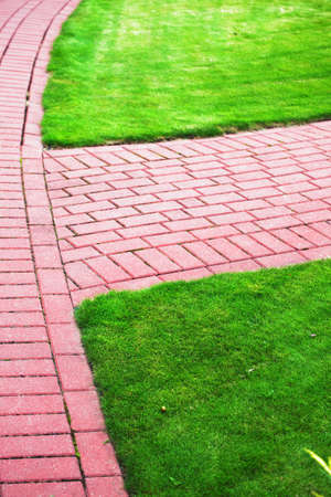 pavers: Garden stone path with grass growing up between and around stones, Brick Sidewalk