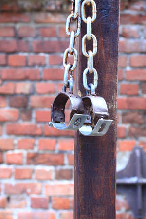 manacles: old fetters, manacles brick two old rusted iron rings on wall background