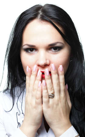 awkward: discreet awkward meaningful silence pretty woman with hands over mouth Stock Photo