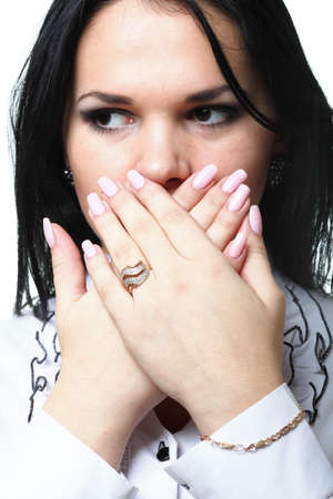 discreet awkward meaningful silence pretty woman with hands over mouth photo
