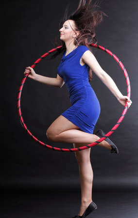 Beautiful woman in a sport wear. Dance hoop gym exercises black background Stock Photo - 12552225